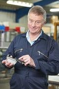 Engineer Measuring Component With Micrometer Stock Photos