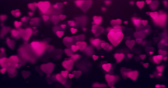 Abstract background with shining heart-shaped bokeh sparkles. - stock footage