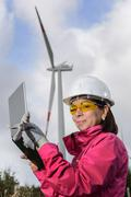 Woman engineer checking wind turbines. Stock Photos