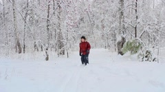 Child in the Woods in winter Stock Footage