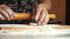 Woman rolling out the paste and cooking ukrainian national vareniks with potato. Stock Footage