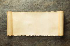 Parchment scroll at wall Stock Photos
