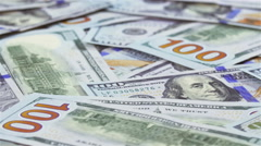 Many 100 US dollars bank notes rotating business background Stock Footage