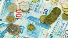 Circulation of hong kong money bill and coins, close up rotation. Stock Footage
