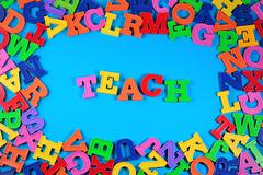 Teach written by plastic colorful letters - stock photo