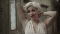 Marilyn Monroe close-up glamour shot posing camera under Broadway street light Stock Footage