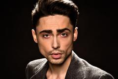 Portrait of model man's face in studio - stock photo