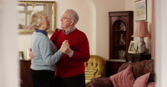 Happy senior couple dancing at home. Shot on RED Epic. Stock Footage