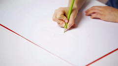 Girl hands with colour pencil drawing cat on paper Stock Footage