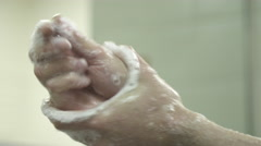 Surgeon washing hands before surgery Stock Footage