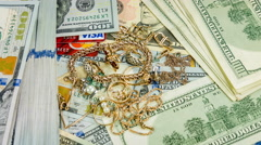 Circulation of dollar bills and jewerly, close up rotation. Stock Footage