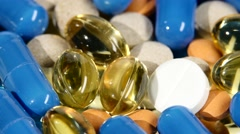 Colored medical pills, tablets and capsules, rotation, close up - stock footage
