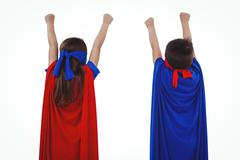 Masked kids pretending to be superheroes - stock photo