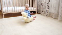 Baby boy playing with toys indoors Stock Footage