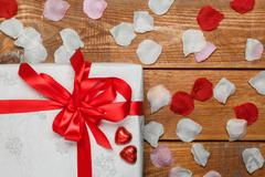 Stock Photo of Valentines Day gift and hearts  on wooden background