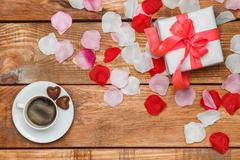 Valentines Day gift and coffee  on wooden background - stock photo