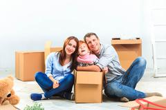The happy family  during repair and relocation Stock Photos