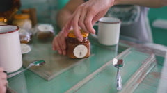 The man is going to drink tea with honey. Close-up Stock Footage