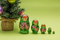 Russian wooden dolls and a Christmas tree Stock Photos