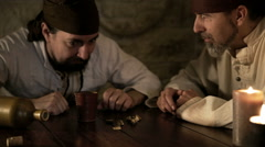 Two pirates playing dices Stock Footage