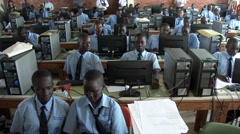 Long shot & pan-African students at computer lab in school - Education in Africa Arkistovideo