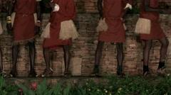 Legs of African tribe dancers, tribesmen dance sing songs drum jump clap Stock Footage