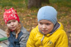 two children in a park in autumn, portrait - stock photo