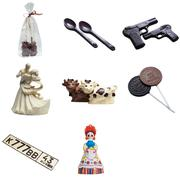 Gift chocolates in form of amusing figures Stock Photos