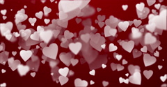 Abstract background with white heart-shaped particles in soft focus. - stock footage