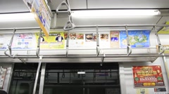Train ads on inside of moving train - Tokyo Japan Stock Footage