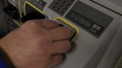 White male putting coins into train ticket machine, japan Stock Footage
