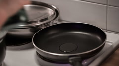 Pouring oil into frying pan Stock Footage