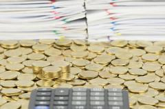 Pile of gold coins on stack of gold coins - stock photo