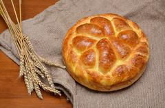 Delicious home made bread and wheat ears - stock photo