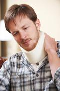 Man Wearing Surgical Collar In Pain - stock photo