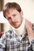 Young Man Wearing Surgical Collar - stock photo