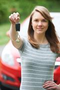 Young Female Driver Holding Car Keys In Front Of Vehicle Stock Photos