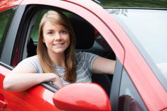 Portrait Of Young Female Driver In Car Stock Photos