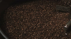 Coffee machine mixes coffee beans.  Slow motion. Close-up Stock Footage