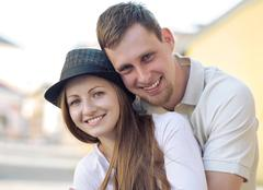 Smiling happiness couple funing on the street. - stock photo