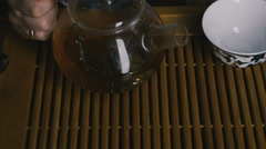 Pour the tea into a cup. Close-up. Slow motion Stock Footage