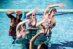 Stock Photo of Fitness group doing aqua aerobics