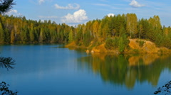 Aututmn lake landscape in Ural mountains, zoom in Stock Footage