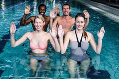 Stock Photo of Fitness class doing aqua aerobics on exercise bikes
