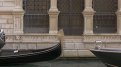 Stock Video Footage of Gondola and water taxi moving on a canal in Venice