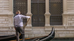 Three gondolas traveling in a canal in Venice Stock Footage