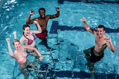 Stock Photo of Fit people doing an aqua aerobics class