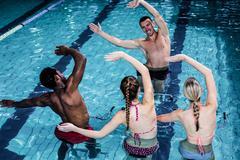 Stock Photo of Fit people doing an aqua aerobics class