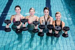 Fit people doing an aqua aerobics class Stock Photos