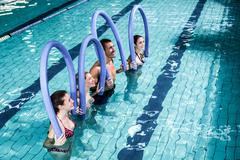 Fit group doing aerobical excercises Stock Photos